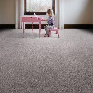 Girl with piano on Carpet flooring | Westport Flooring