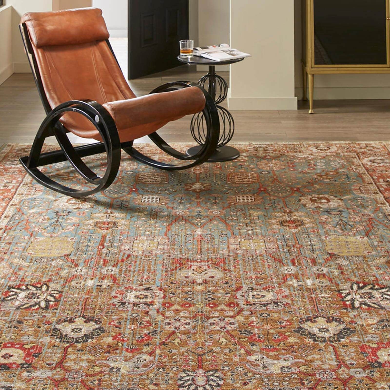 Armchair on area rug | Westport Flooring