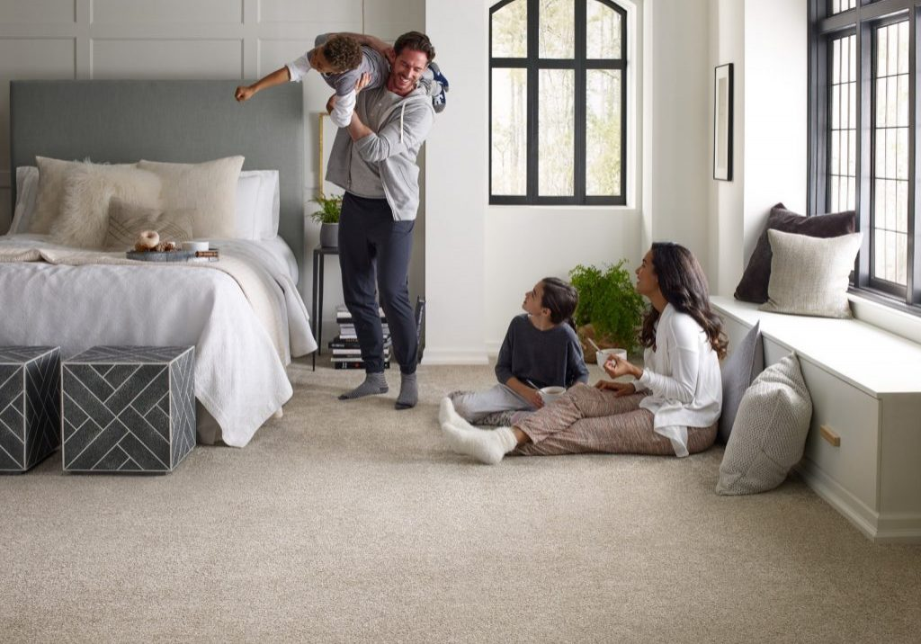 Family enjoying in bedroom | Westport Flooring