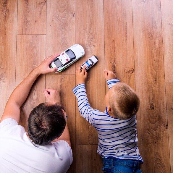 kid and father on floor | Westport Flooring