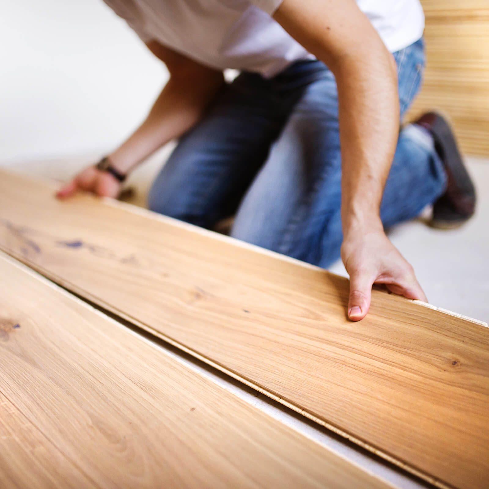 Man installing laminate flooring | Westport Flooring