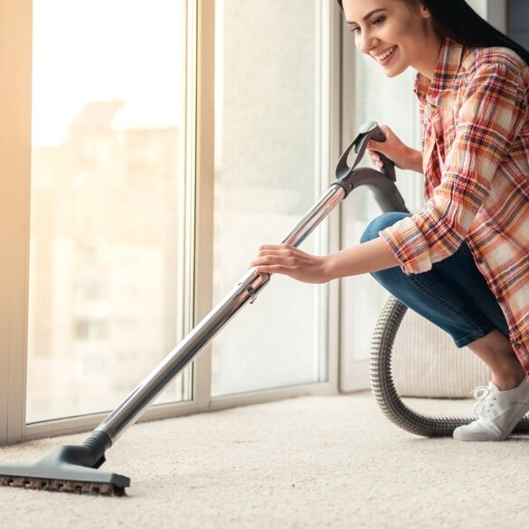 Woman cleaning Carpet | Westport Flooring